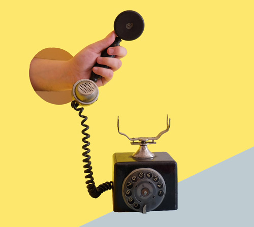 Hand holding old rotary telephone